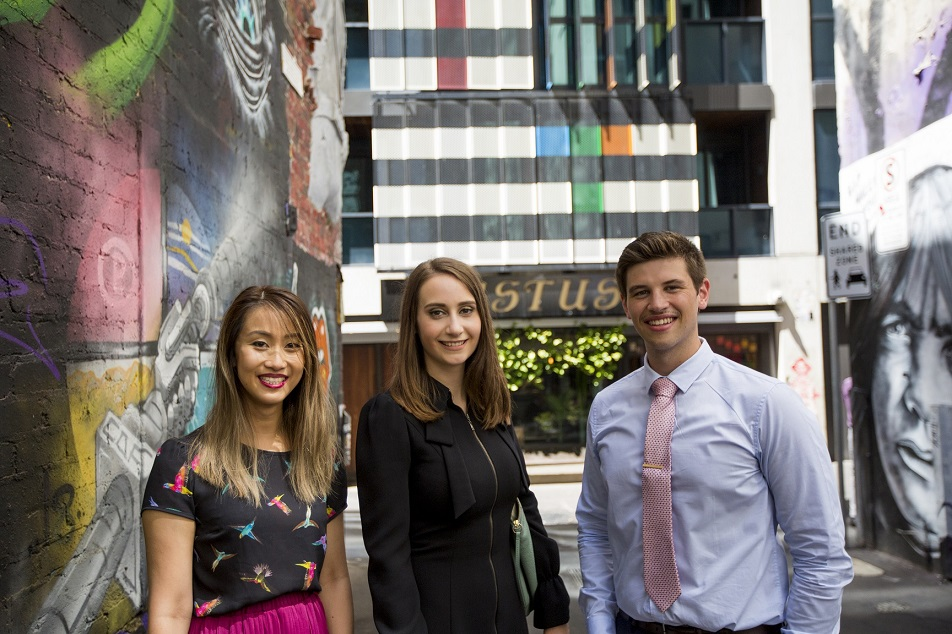 Three graduates at the Department of Justice and Community Safety