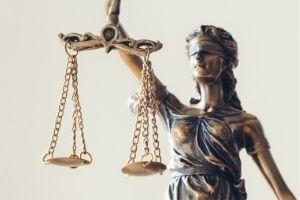 statue of Lady Justice holding as set of scales