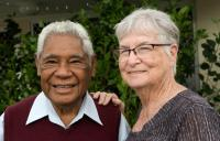 A smiling older couple
